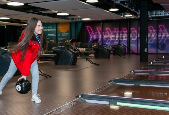 A young woman bowling