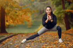 Girl doing stretching exercises in the park