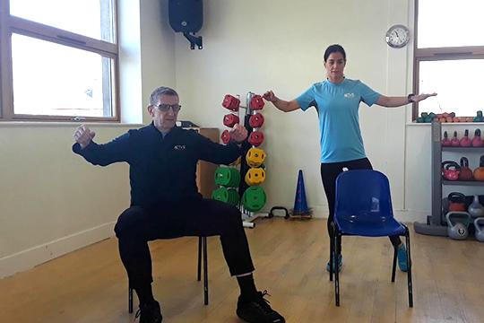 man doing chair based exercise