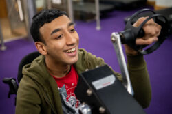 Everybody Can service user trying out the gym equipment
