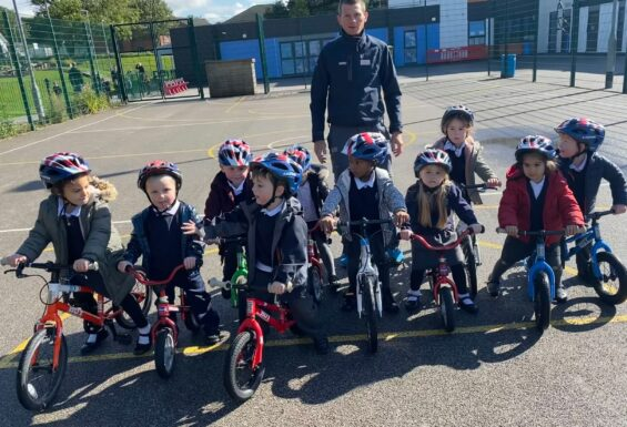 British Cycling coach Simon Wilson with reception pupils at Silver Springs Primary Academy in Stalybridge